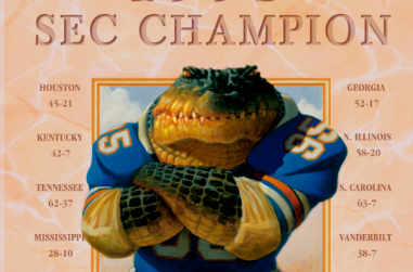 A defiant florida gator in football attire standing with his arms crossed