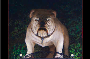 A menacing Georgia bulldog standing on a statue with the arches behind him
