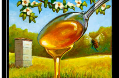 A large spoon pouring honey into a pond of honey