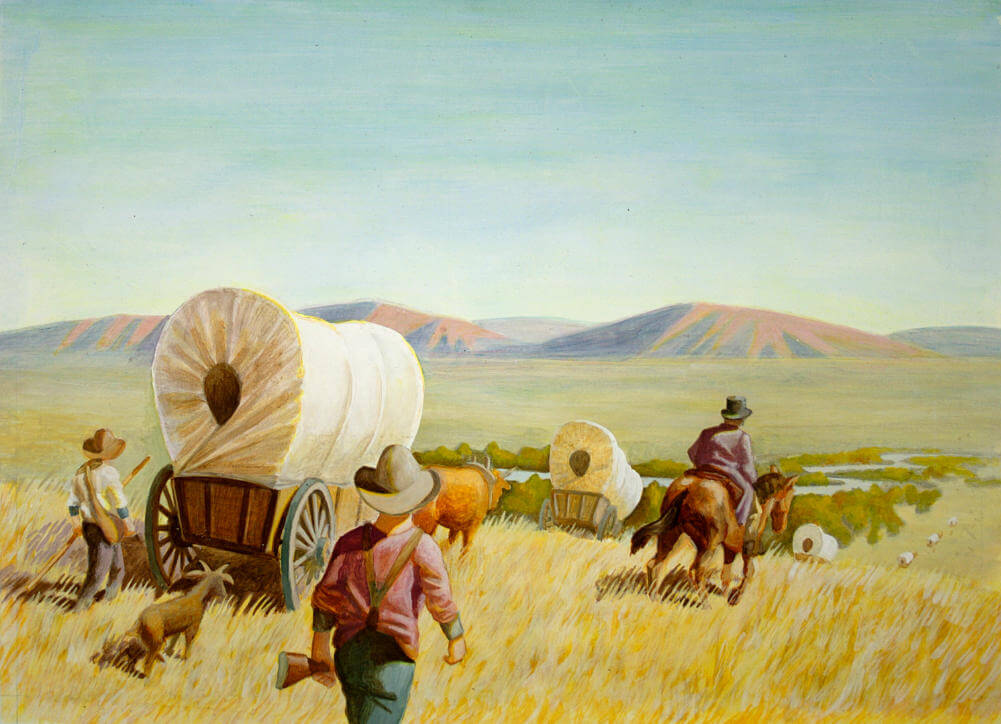a wagon train traveling across the plains